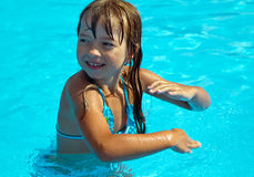 Happy girl dancing in pool royalty free stock photos