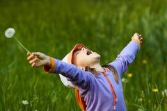 Happy girl with dandelion Stock Photos