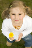 Happy girl with dandelion Royalty Free Stock Images