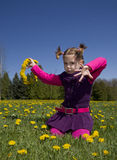 Happy girl in dandelions Stock Photos
