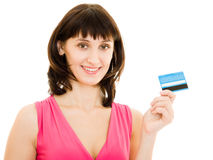 Happy girl with  debit card in the red dress Royalty Free Stock Photos