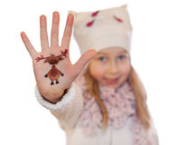 Happy girl demonstrating Christmas symbol painted on her hand.  reindeer Stock Photography