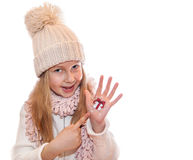 Happy girl demonstrating Christmas symbols painted on hands. Christmas present Royalty Free Stock Photos