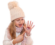 Happy girl demonstrating Christmas symbols painted on hands. Christmas present Stock Images