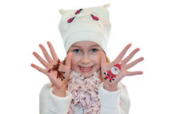 Happy girl demonstrating Christmas symbols painted on hands. Santa Claus and reindeer Royalty Free Stock Image