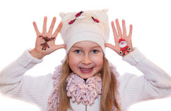 Happy girl demonstrating Christmas symbols painted on hands. Santa Claus and reindeer Stock Image
