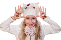 Happy girl demonstrating Christmas symbols painted on her hands Royalty Free Stock Image
