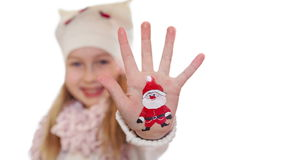 Happy girl demonstrating painted Christmas symbols on her hands. Santa stock video footage