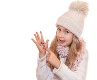 Happy girl demonstrating painted Christmas symbols on her hands. Santa Claus, Reindeer Stock Photo