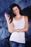 Happy girl on a denim background Stock Photography