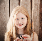 Happy girl with dessert Stock Image