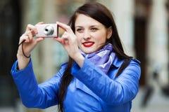 Happy girl with digital camera Stock Photo