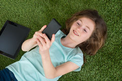 Happy Girl With Digital Tablet And Mobile Phone Royalty Free Stock Photo