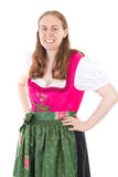 Happy girl in dirndl smiling to you Royalty Free Stock Photo
