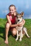 Happy girl with dog Stock Photos
