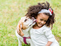 Happy girl with a dog Royalty Free Stock Photos