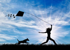 Happy girl with dog playing with kite Royalty Free Stock Images