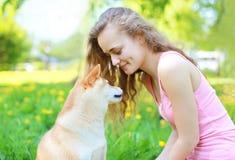 Happy girl and dog Stock Image