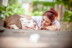 Happy girl and dog stock images