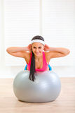 Happy girl doing abdominal crunch on fit ball Stock Photo