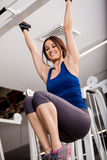 Happy girl doing bar pull ups Stock Photos