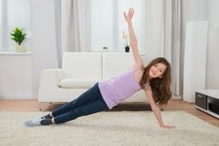 Happy Girl Doing Exercise At Home Royalty Free Stock Photo