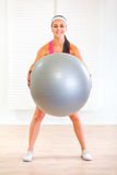 Happy girl doing exercises with fit ball Stock Images