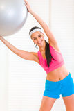 Happy girl doing exercises with fitness ball Royalty Free Stock Photos