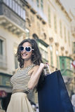 Happy girl doing shopping Royalty Free Stock Photography