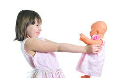 Happy girl with doll. Isolated on the white background Royalty Free Stock Photo