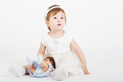 Happy girl with doll Royalty Free Stock Photo