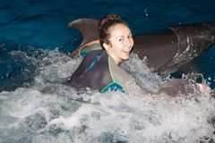 Happy girl and dolphin Stock Photo