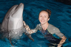 Happy girl and dolphin. Photo happy girl and dolphin in blue water stock photos