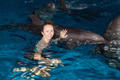 Happy girl and dolphin. Photo happy girl and dolphin in blue water royalty free stock photo