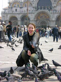 Happy girl with doves Stock Image