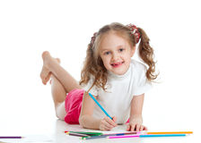 Happy girl drawing with color pencils Stock Photos