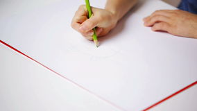 Happy girl drawing with colour pencils at home stock footage