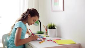 Happy girl drawing at home stock video