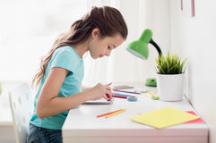 Happy girl drawing at home Royalty Free Stock Photography