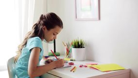 Happy girl drawing at home stock video footage