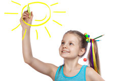 Happy girl draws the sun Royalty Free Stock Photos