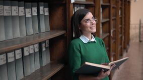 Girl Readng the Book in Library stock footage
