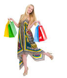 Happy girl in dress holding shopping bags Royalty Free Stock Photography