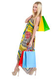 Happy girl in dress holding shopping bags Royalty Free Stock Photos