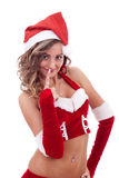 Happy girl dressed as Santa. On a white background Royalty Free Stock Photo