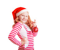 Happy girl dressed in Santa Claus hat Royalty Free Stock Image