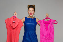 Happy girl with dresses Royalty Free Stock Image