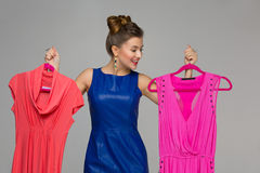 Happy girl with dresses Royalty Free Stock Photos