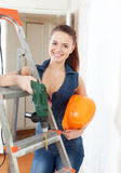 Happy girl with drill and hardhat Stock Photo