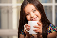 Happy girl drinking chocolate Royalty Free Stock Photos
